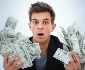 Surprised man holding money