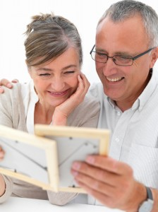 Mature romantic couple looking at photos