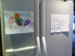 Kids drawings on fridge